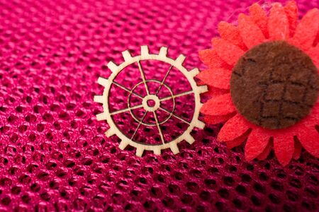 Gear wheel and fake flower as The concept of mechanism