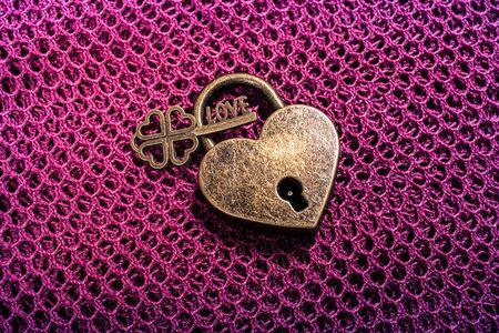 Metal padlock in heart shape as  symbol of love