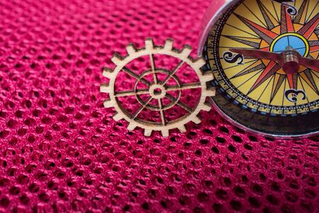 Gear wheel and a compass as The concept of mechanism