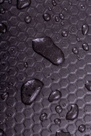 Water drops on metal  with geometric  patterns 写真素材