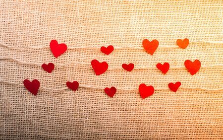 Love concept with heart shaped papers on linen threads Stok Fotoğraf