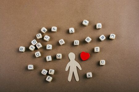 Letter cubes of made of wood and man figurine and heart shape