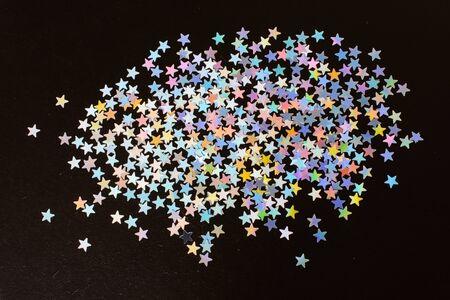 Colorful confetti  stars on a dark