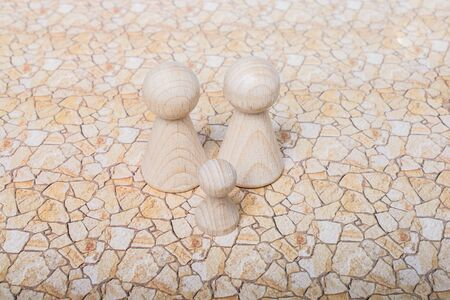 Wooden figurines of  family as concept of caring for children