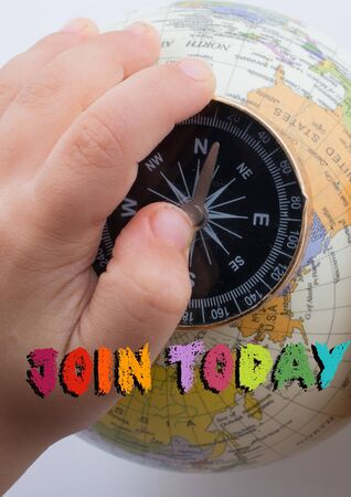 Hand holding  compass on globe with  Join Today wording on it