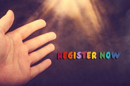 Register now wording written on grunge background with lights