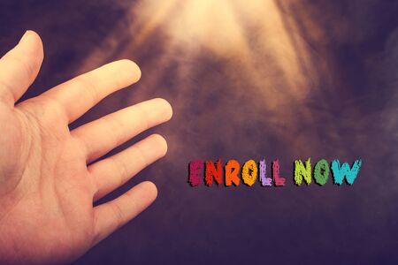 Enroll now wording written on a grunge background Stockfoto