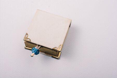 Tiny figurine of man models found beside a book Standard-Bild