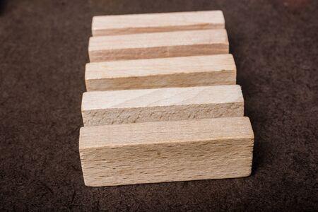 Wooden piece of domino wood on dark background Stock fotó