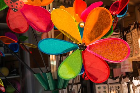 Rainbow colored pinwheels on sale in the view Stok Fotoğraf