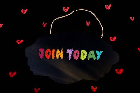 Hand holding sign board  with  Join Today wording on it