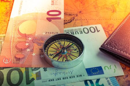 Compass,  box, wallet and Euro banknotes  as business concept 스톡 콘텐츠