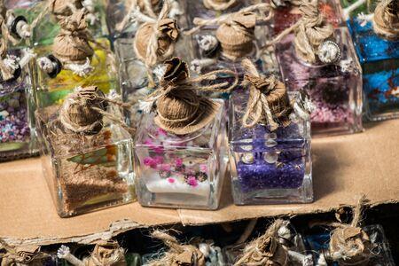 Plenty of little colorful decorative bottles on shelf Banco de Imagens