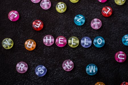 Hello wording formed with Multi color alphabet letter beads Imagens