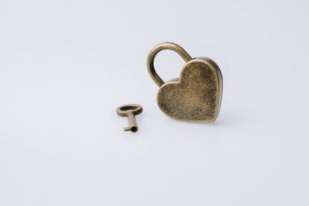 Metal padlock in heart shape as  symbol of love