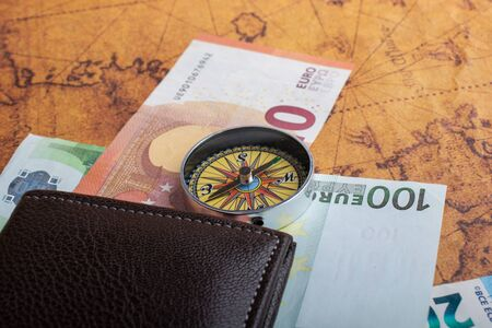 Compass, box, wallet and Euro banknotes as business concept
