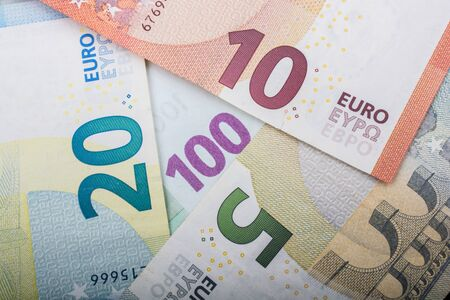 Financial background. Euro banknotes.  Business, finance, investment, saving, corruption concept. Фото со стока
