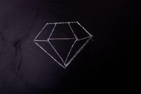Chalk drawn diamond on a blackboard in the view