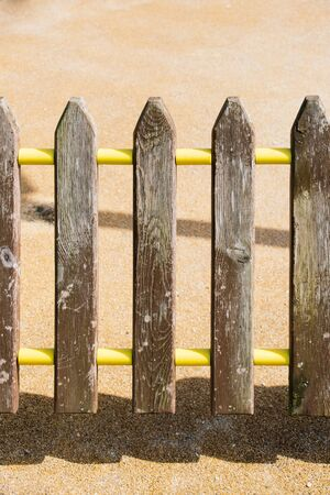 Part of a fence made of wood in view