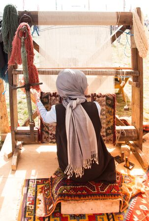 Carpet of  traditional types made on a loom and a girl