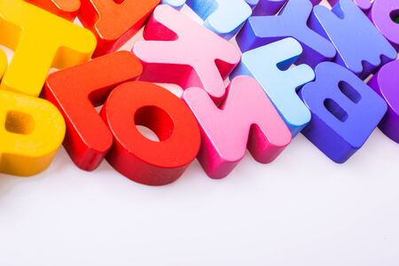 Colorful alphabet letter blocks scattered randomly on white background 版權商用圖片