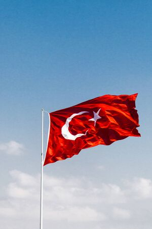 Turkish national flag with white star and moon on red background