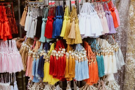 Set of tassels in various colors for design elements in view