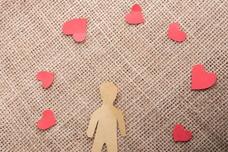Love concept for with paper hearts and paper man Stock Photo