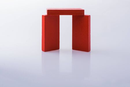 Red color domino blocks placed on a white background