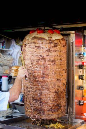 Traditional Turkish food Doner Kebab. Turnspit skewing kebap  kebab shawarma