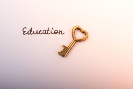 Education wording beside a retro style key  as education concpt