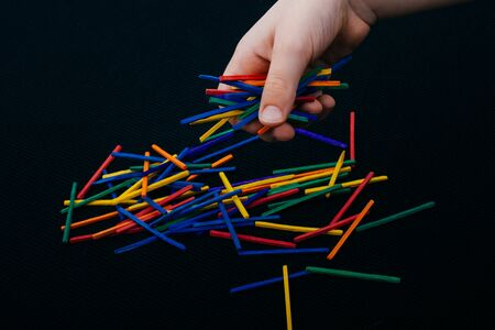 Beautiful coloured wooden  sticks for creativity on black background