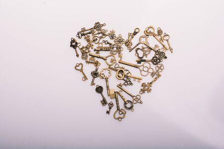 Retro  metal keys form a heart shape on white