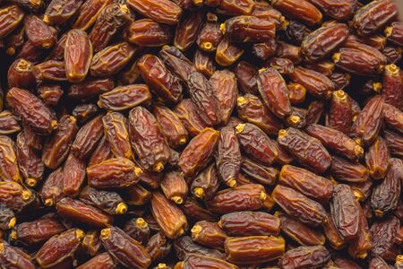 Delicious and sweet dried dates fruit background
