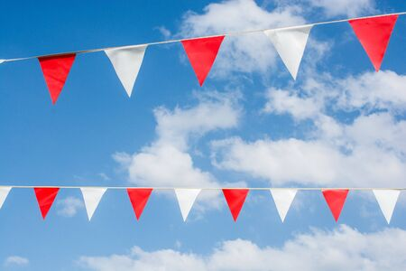 Colorful triangle bunting flags of various colors as festival concep