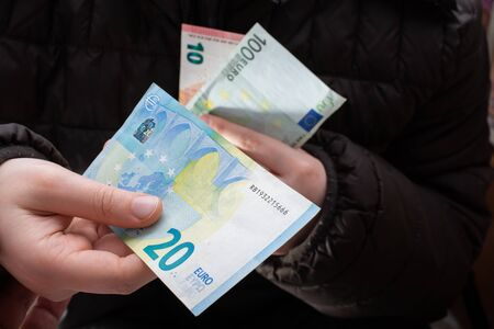 Hands giving  euro banknotes currencies as  financial activity Stok Fotoğraf