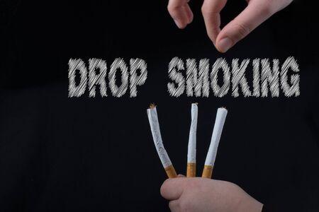 wording DROP SMOKING as, say no smoking concept