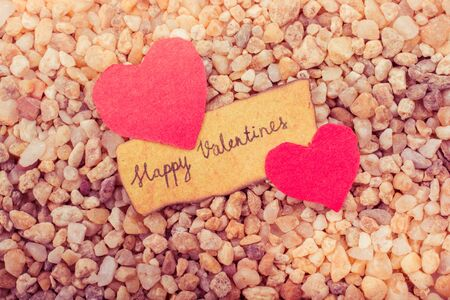Love icon and Valentines day wording on torn paper Stockfoto