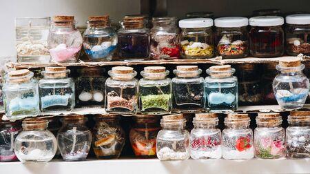 Plenty of little colorful decorative bottles on shelf