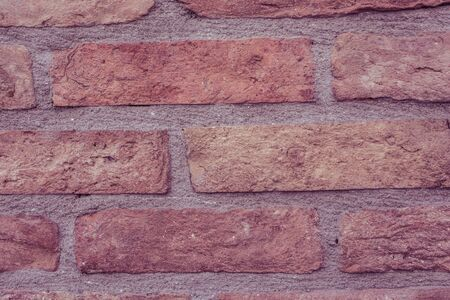 Old vintage grunge brick wall background texture with place for text. Фото со стока