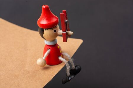 Colorful wooden pinocchio doll with his long nose