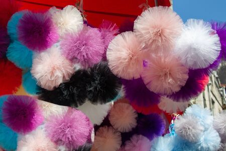 Collection of  fluffy pompons. The concept of touch, tactility, feelings.