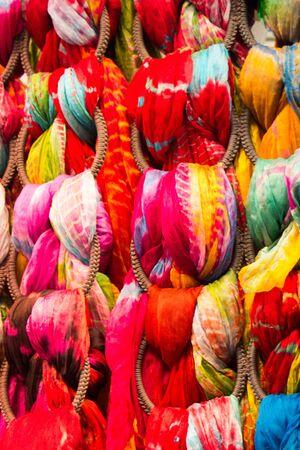 Pile of bright Multi-colored pieces of fabric in a bazaar 版權商用圖片