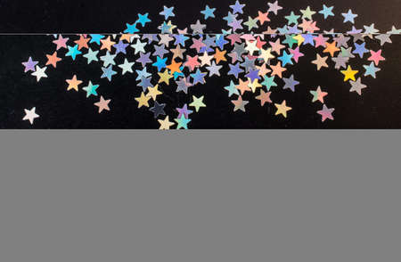 Colorful confetti  stars on a dark background 免版税图像