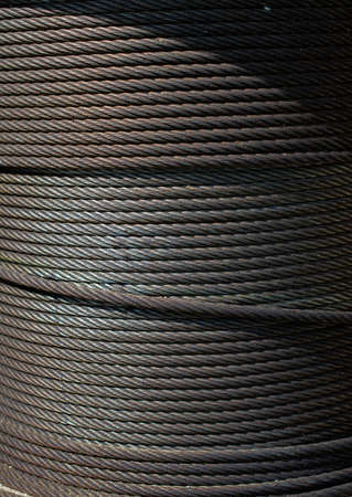 Metal wire roll close-up. Pattern of cables in view.