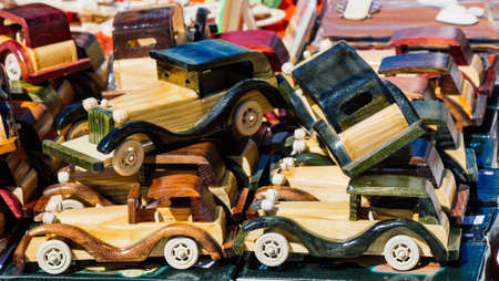 Closeup of multicolored wooden toy cars in view