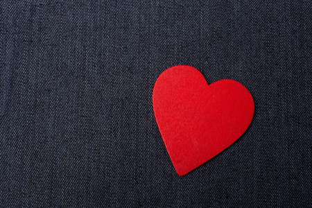 Red heart shaped on black color for love card and valentine day concept