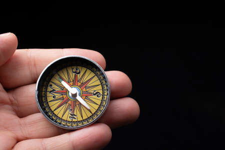 Compass tool in hand o as travel concept