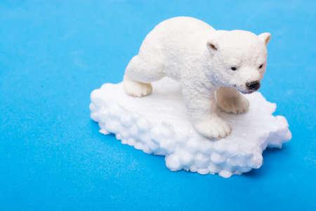 Fake Polar bear cub  on fake snow and sea background environment Stok Fotoğraf