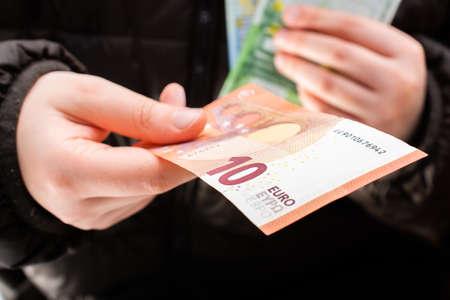 Hands giving  euro banknotes currencies as  financial activity Stok Fotoğraf
